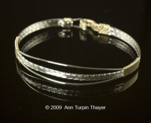 Glistening Strands of Silver and Gold Bangle